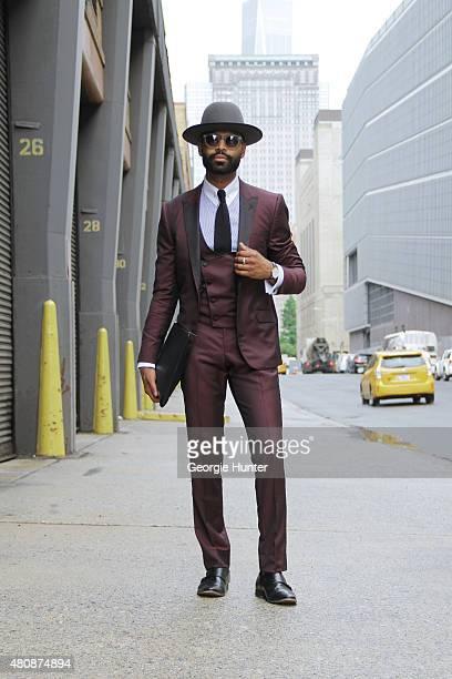Kash Rav seen at Skylight Clarkson Sq outside the Michael Bastian show wearing Jaan Choxi suit Surmer shirt Chaaman tie Brimz Official hat Aldo shoes...