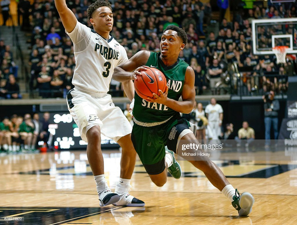 Kasheem Thomas #12 of the Cleveland State Vikings drives to the basket against Carsen Edwards #3 of the Purdue Boilermakers at Mackey Arena on December 10, 2016 in West Lafayette, Indiana.