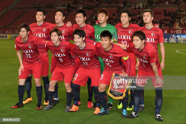 Kashima Anlters players line up for the team photos prior to the AFC Champions League Round of 16 first leg match between Kashima Antlers and...