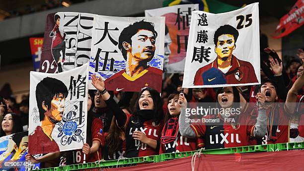 Kashima Antlers fans cheer prior to the FIFA Club World Cup second round match between Mamelodi Sundowns and Kashima Antlers at Suita City Football...