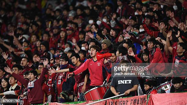 Kashima Antlers fans sing during the FIFA Club World Cup second round match between Mamelodi Sundowns and Kashima Antlers at Suita City Football...