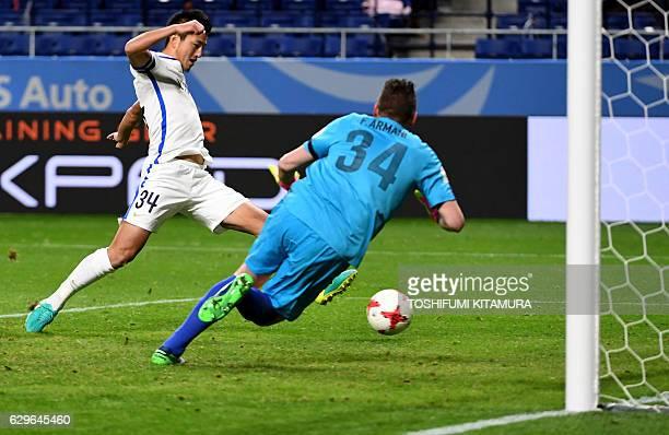 Kashima Antlers forward Yuma Suzuki scores a goal past Atletico Nacional goalkeeper Franco Armani during the Club World Cup football semifinal match...