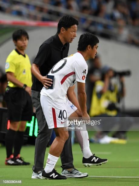 Kashima Antlers head coach Go Oiwa gives instruction to Mitsuo Ogasawara during the JLeague Levain Cup quarter final second leg between Kawasaki...
