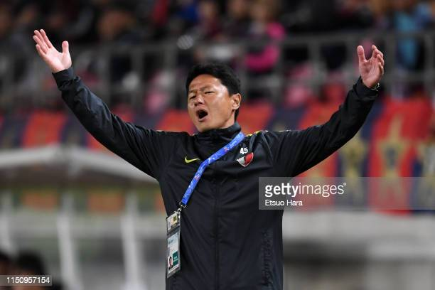 Kashima Antlers head coach Go Oiwa reacts during the AFC Champions League Group E match between Kashima Antlers and Shandong Luneng at Kashima Soccer...
