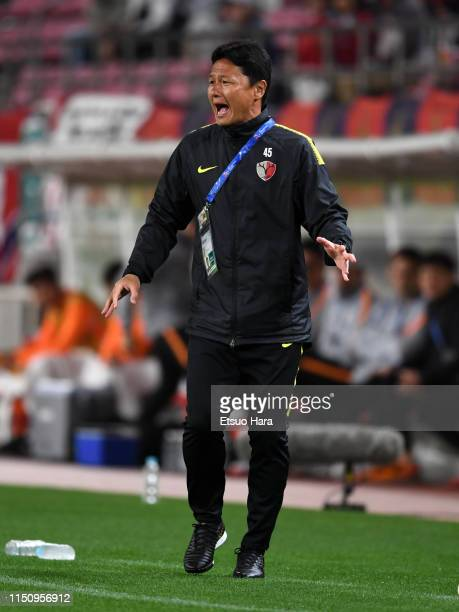 Kashima Antlers head coach Go Oiwa shouts during the AFC Champions League Group E match between Kashima Antlers and Shandong Luneng at Kashima Soccer...