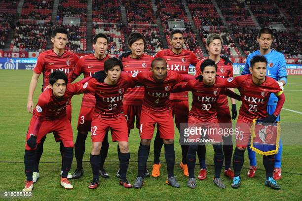 Kashima Antlers line up for the team photos prior to the AFC Champions League Group H match between Kashima Antlers and Shanghai Shenhua at Kashima...