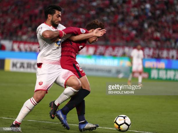Kashima Antler's midfielder Kento Misao fights for the ball with Persepolis' midfielder Siamak Nemati during the AFC Champions League final football...