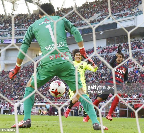 Kashima Antlers midfielder Leandro scores in the second half of a JLeague first division match against Urawa Reds at Kashima Soccer Stadium in...