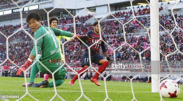 Kashima Antlers midfielder Leandro scores past Urawa Reds goalkeeper Shusaku Nishikawa in the second half of a JLeague first division match at...