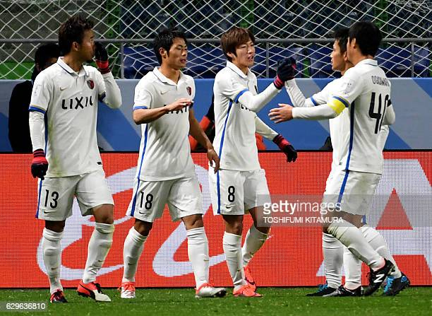 Kashima Antlers midfielder Shoma Doi celebrates his goal with teammates during the Club World Cup football semifinal match between Colombia's...