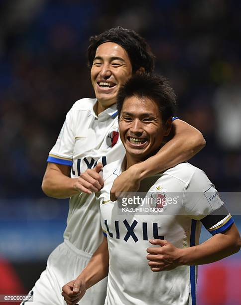 Kashima Antlers midfielder Yasushi Endo celebrates his goal with teammate Mu Kanazaki during the Club World Cup football match between Kashima...
