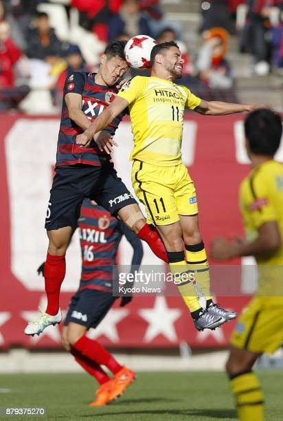 Kashima Antlers' Naomichi Ueda and Kashiwa Reysol's Diego Oliveira vie for the ball during the second half of a 00 draw in the JLeague first division...