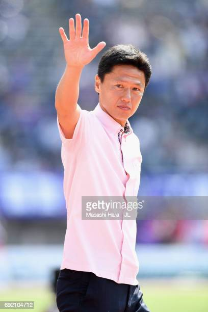 Kashima Antlers new head coach Go Oiwa applauds supporters after his side's 31 victory in the JLeague J1 match between Sanfrecce Hiroshima and...