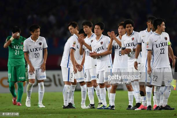 Kashima Antlers players applaud supporters after the 2-2 draw in the J.League J1 match between FC Tokyo and Kashima Antlers at Ajinomoto Stadium on...