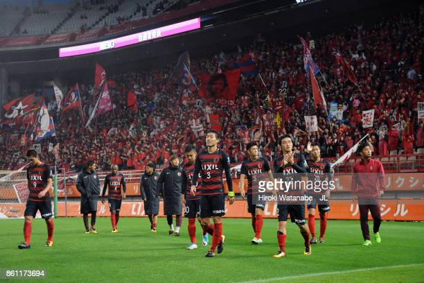 Kashima Antlers players applaud supporters after their 20 victory in the JLeague J1 match between Kashima Antlers and Sanfrecce Hiroshima at Kashima...