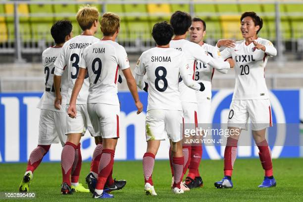 Kashima Antlers' players celebrate a goal during the AFC Champions League semifinal football match between South Korea's Suwon Samsung Bluewings and...