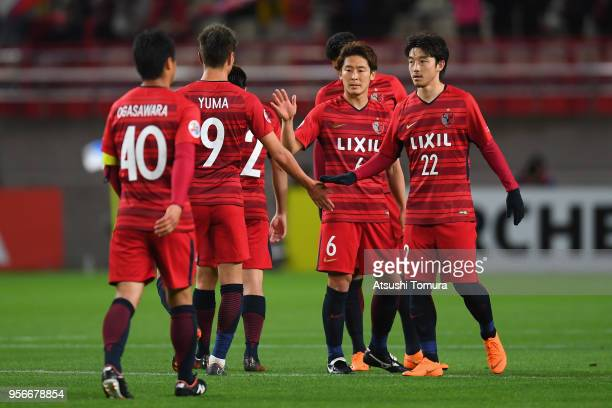 Kashima Antlers players celebrate after their 31 victory in the AFC Champions League Round of 16 first leg match between Kashima Antlers and Shanghai...