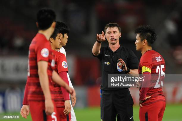 Kashima Antlers players protest to referee Tantashev Ilgiz during the AFC Champions League Round of 16 first leg match between Kashima Antlers and...