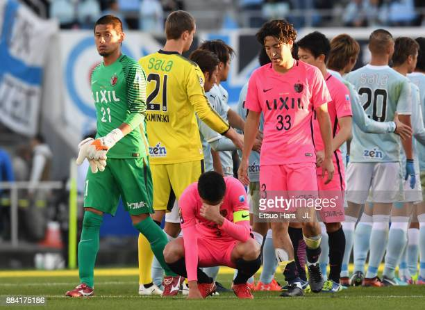 Kashima Antlers players show dejection after the scoreless draw and missing the title in the JLeague J1 match between Jubilo Iwata and Kashima...