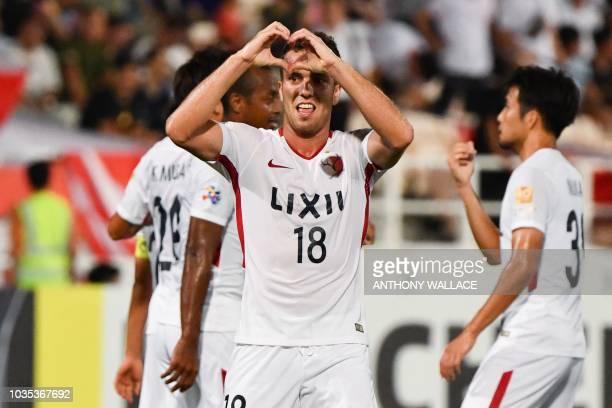 Kashima Antlers' Serginho celebrates his goal during the Asian Champions League quarterfinal football match between China's Tianjin Quanjian and...