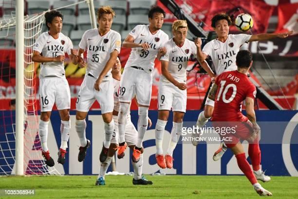 Kashima Antlers' Shuto Yamamoto Jung SeungHyun Tomoya Inukai Yuma Suzuki and Kento Misao defend a freekick taken by Tianjin Quanjian's Alexandre Pato...