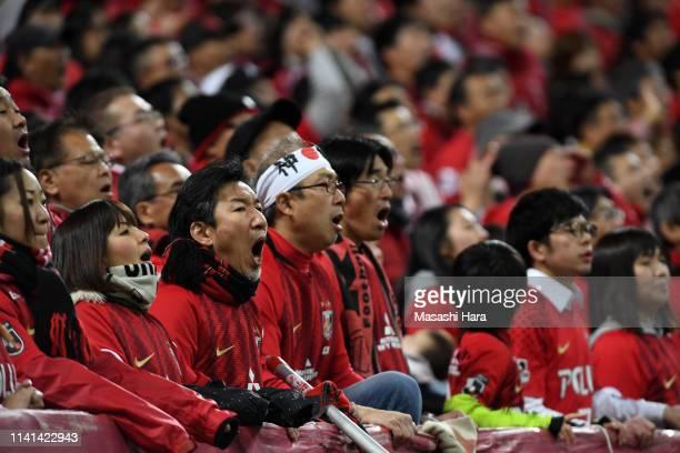 Kashima Antlers supporters cheer during the AFC Champions League Group G match between Urawa Red Diamonds and Jeonbuk Hyundai Motors at Saitama...
