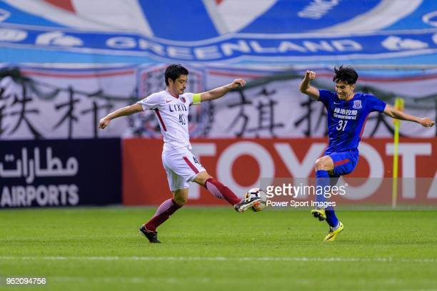 Kashima Midfielder Ogasawara Mitsuo in action against Shenhua Midfielder Wang Wei during the AFC Champions League 2018 Group Stage F Match Day 5...