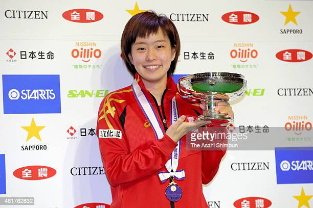 Kashimi Ishikawa poses for photographs with the trophy after winning the Women's Singles during day seven of the All Japan Table Tennis Championships...
