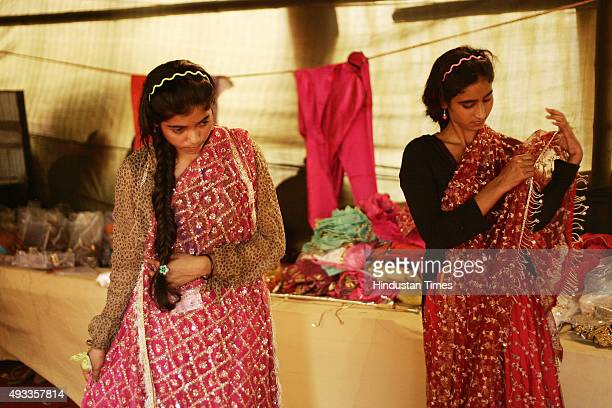 Kashish and Farah Khan who play the roles of Suparnkha and Sabri get ready backstage during Ramleela on October 19 2015 in Greater Noida India Only...