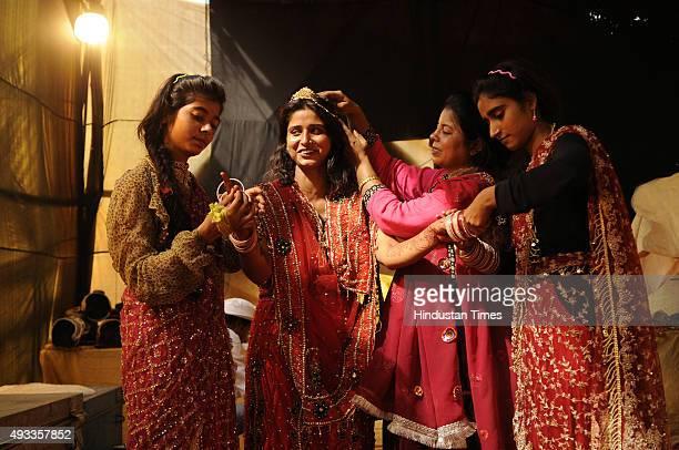Kashish Farhana Khan Poonam Khan and Farah Khan who play the roles of Suparnkha Sita KaiKai and Sabri get ready backstage during Ramleela on October...