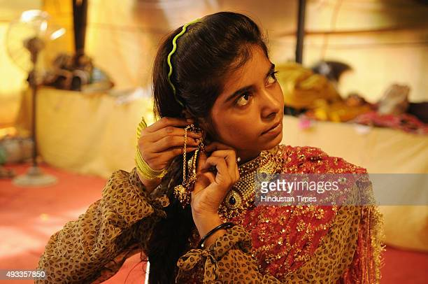 Kashish who plays the role of Suparnkha gets ready backstage during Ramleela on October 19 2015 in Greater Noida India Only 30 km away from Bisada...
