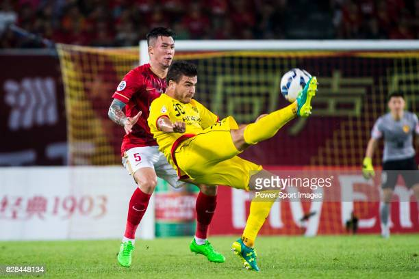 Kashiwa Reysol forward Cristiano Da Silva fights for the ball with Guangzhou Evergrande defender Zhang Linpeng during the Guangzhou Evergrande vs...