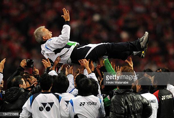 Kashiwa Reysol head coach Nelsinho is thrown into the air as Kashiwa Reysol won the 2011 JLeague after the JLeague match between Urawa Red Diamonds...