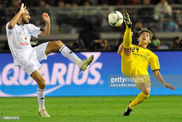 Kashiwa Reysol player Koki Mizuno and Al Sadd player Mamadou Niang fight for the ball during their football match for third place of the Club World...