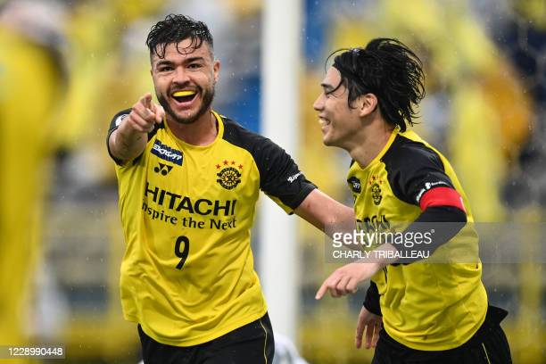 Kashiwa Reysol's Japanese midfielder Hidekazu Otani celebrates his goal with his teammate Brazilian forward Cristiano da Silva during the J-League...