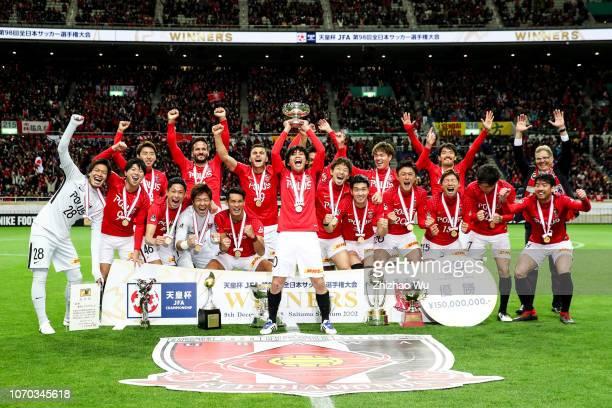Kashiwagi Yosuke of Urawa Red Diamonds leads the players of Urawa Red Diamonds celebrate the champion after the 98th Emperor's Cup Final between...