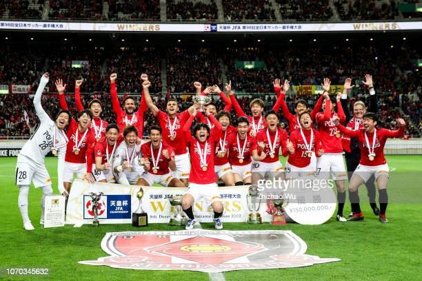 Kashiwagi Yosuke of Urawa Red Diamonds leads the players of Urawa Red Diamonds as they celebrate becoming champions after the 98th Emperor's Cup...