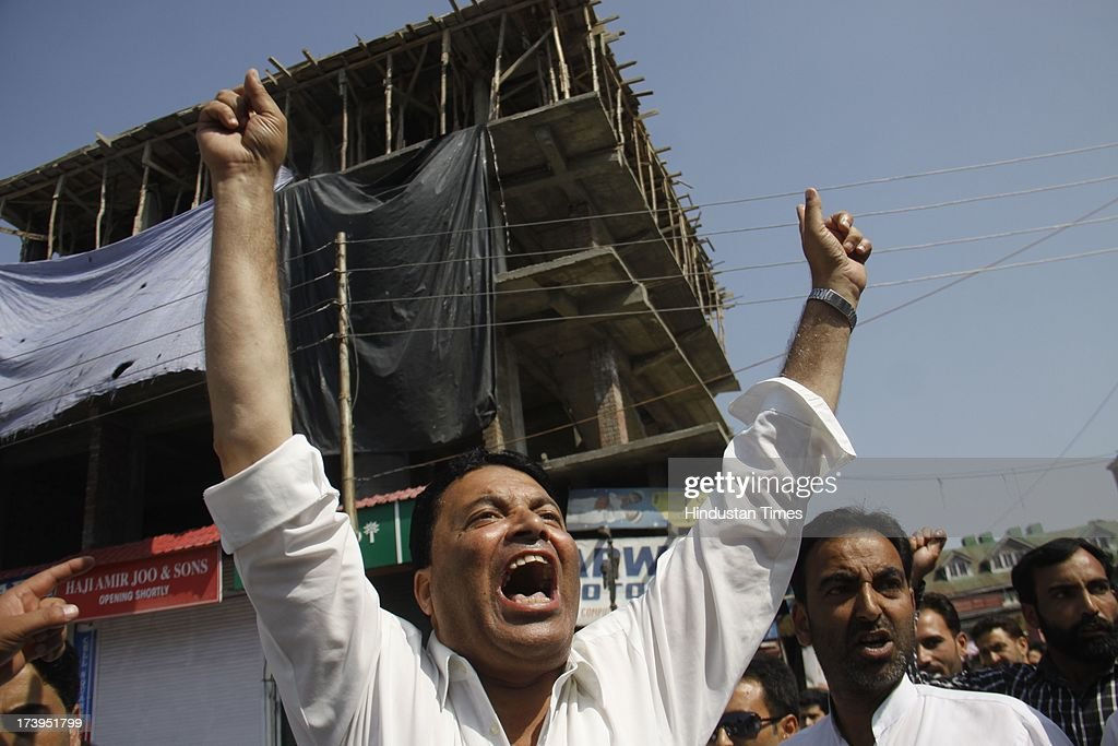 Kashmir bar association members shout slogans during a protest against killing of 4 people in BSF firing on July 18, 2013 in Srinagar, India. Four people were killed today when security personnel opened fire at a mob that had gathered at a BSF camp in Ramban district protesting against alleged manhandling of an Imam of the area by the force. Curfew would be imposed in Srinagar and all other major towns in the Kashmir Valley from Friday morning as a precautionary measure.