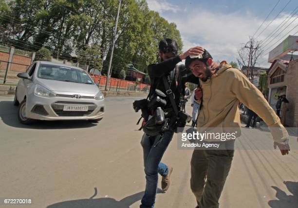 Kashmir based photojournalist Basit Zargar being shifted for medical aid after a stone hit his head during clashes among students and Indian police...