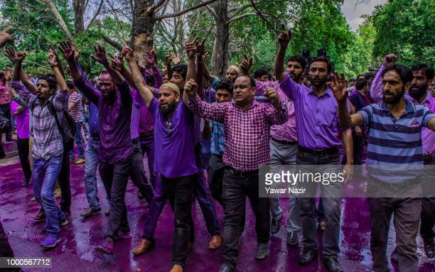 Kashmir government teachers shout anti government slogans during a protest against the government on July 17 2018 in Srinagar the summer capital of...