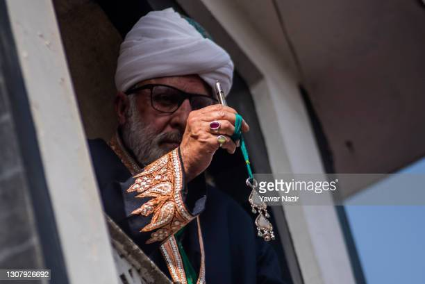 Kashmir Muslim cleric displays the holy relic believed to be the whisker from the beard of the Prophet Mohammed at the Hazratbal Shrine, on March 19,...
