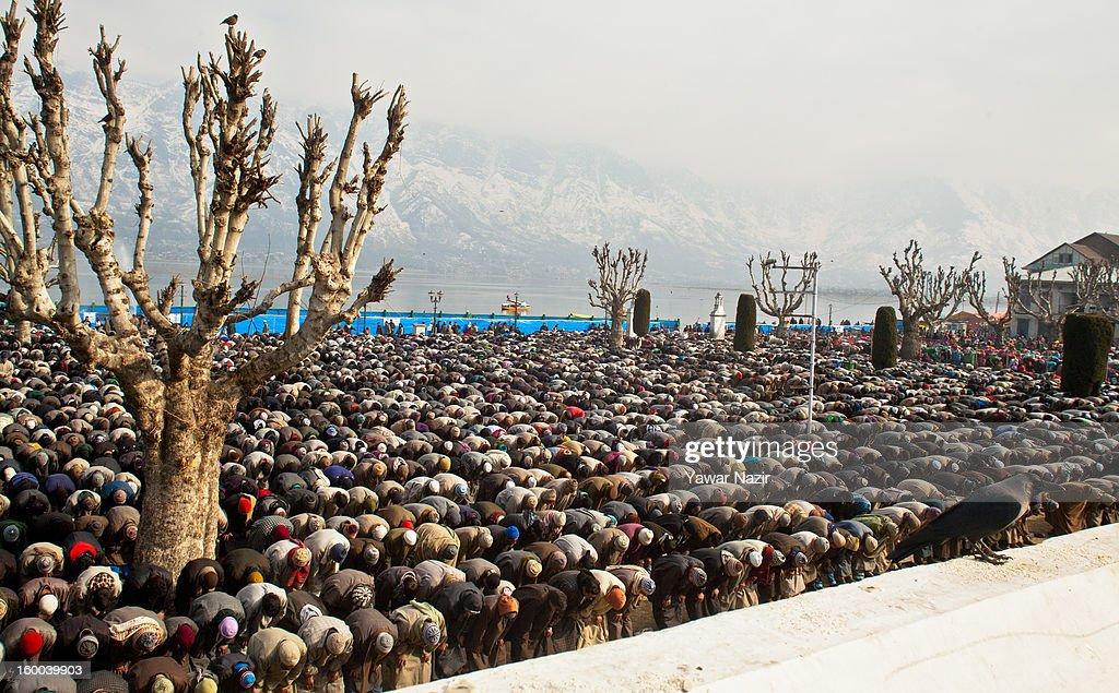 Kashmir Muslim pray at Hazratbal shrine during Eid-e-Milad, the anniversary of the birth of the Prophet Mohammed January 25, 2013 in Srinagar, the summer capital of Indian administered Kashmir, India. Thousands of Muslims from different parts of Kashmir will visit the Hazratbal shrine in Srinagar to pay obeisance on the occasion of Eid-e-Milad. The shrine is highly revered by Kashmiri Muslims as it is believed to house a holy relic of the Prophet Mohammed. The relic is displayed to the devotees on important Islamic days such as the Eid- Milad when Muslims worldwide celebrate the Prophet Mohammed.