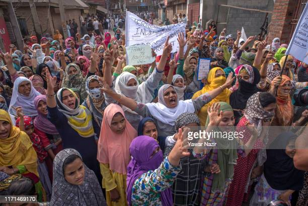 Kashmir Muslim protesters hold banners and placards during an anti India protest in the Aanchar area on September 27 2019 in Srinagar the summer...