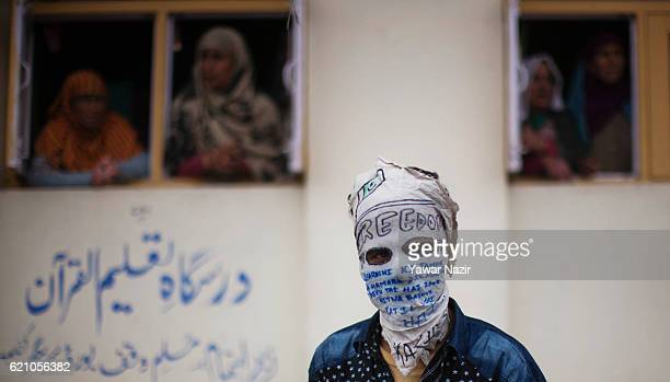 Kashmir Muslim protesters look towards Indian government forces during an anti India protest on November 04 2016 in Srinagar the summer capital of...