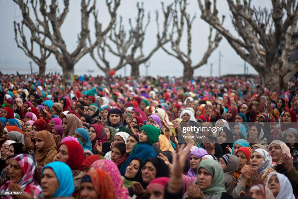 Kashmir Muslim women pray at Hazratbal shrine on the Friday following Eid-e-Milad , or the birth anniversary of Prophet Mohammad on February 01, 2013 in Srinagar, the summer capital of Indian administered Kashmir, India. Thousands of Muslims from all over Kashmir visit the Hazratbal shrine in Srinagar to pay obeisance on the Friday following Eid-e-Milad , or the birth anniversary of Prophet Mohammed. The shrine is highly revered by Kashmiri Muslims as it is believed to house a holy relic of the Prophet Mohammed. The relic is displayed to the devotees on important Islamic days such as the Eid- Milad when Muslims worldwide celebrate.