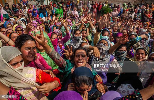 Kashmir Muslim women shout anti Indian slogans during the funeral of Javaid Ahmad who was injured last month when Indian government forces fired at...