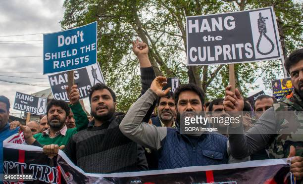 Kashmir Muslims hold placards and chant slogans during a protest in Srinagar the summer capital of Indian administered Kashmir Protesters staged...