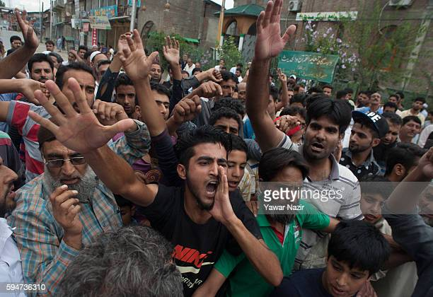 Kashmir Muslims shout anti Indian slogans after Indian police raided an Islamic seminary and tried to arrest a an Islamic scholar for taking part in...