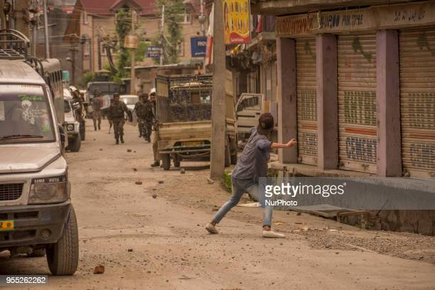 Kashmir Muslims throw stones at Indian government forces near the gun battle site during a gun battle between Indian government forces and rebels on...