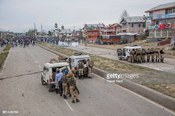 Kashmir protesters throw stones at Indian government forces during a protest on June 22 2018 in Srinagar the summer capital of Indian administered...